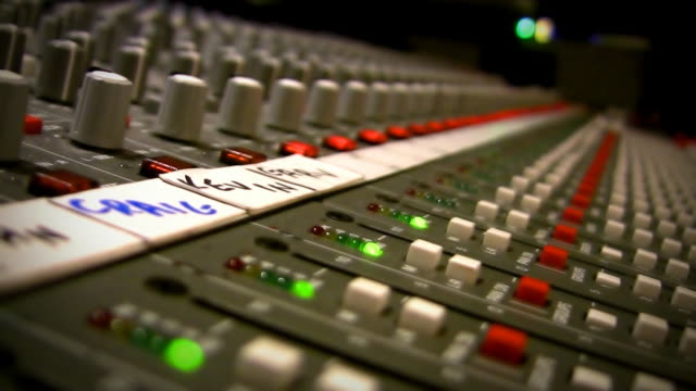 Extreme close up of Mixing console video