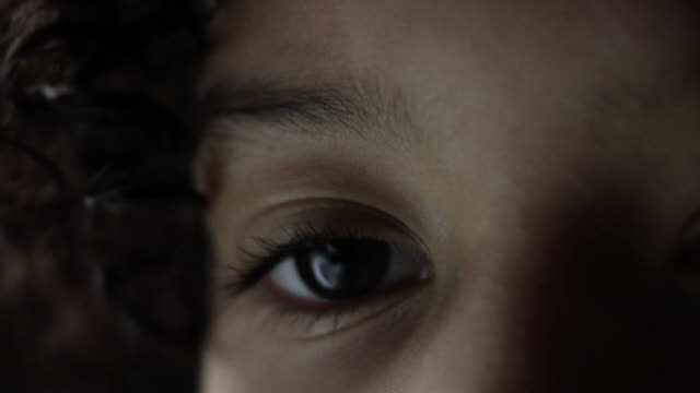 Extreme close up on little girls eye video