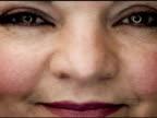 NTSC - Extreme close up: woman smiles video