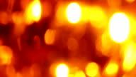 Extreme close-up of soft focused orange LED lights blink video