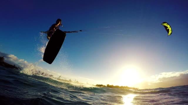 Extreme Kitesurfing Girl at Sunset. Summer Ocean Sport in Slow Motion. video