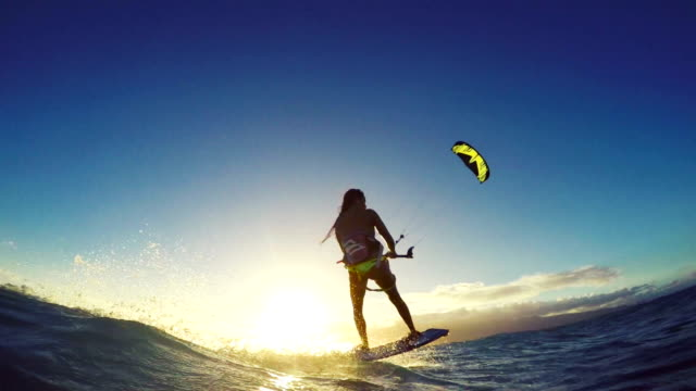 Extreme Kitesurfing Girl at Sunset. Summer Ocean Sport in Slow Motion. video