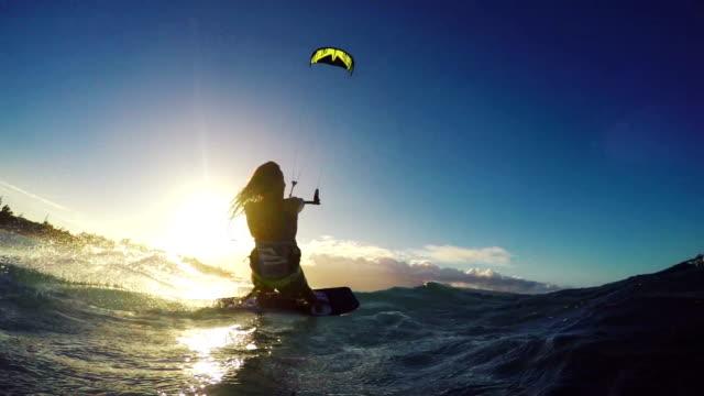 Extreme Kitesurfing Girl Front Flip at Sunset. Summer Ocean Sport in Slow Motion. video