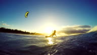 Extreme Kitesurfing on Big Ocean Wave at Sunset. Summer Ocean Sport in Slow Motion. video