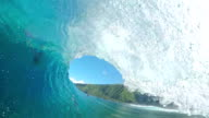 FPV: Extreme pro surfer paddling and riding big barrel wave video