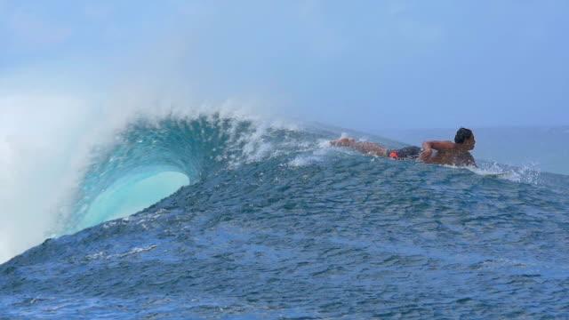 SLOW MOTION: Extreme pro surfer paddling towards the big wave video