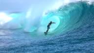 SLOW MOTION: Extreme surfer surfing inside big tube barrel wave video