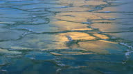 Extremely Cold, Cracked Ice on Rippling Water video