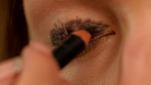 Eye makeup woman applying eyeshadow powder, Close up. Slow motion video