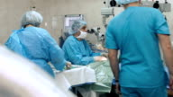 Eye surgery. Doctors in operating room video