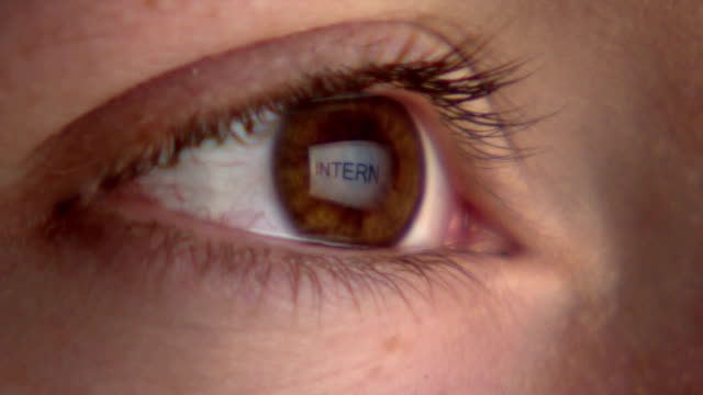 Eye watching the screen with reflection of the word 'internet' video