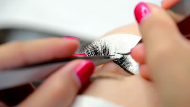 Eyelash extension close-up video