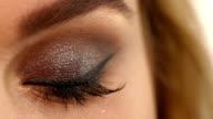 Eyelashes. Cosmetic Eyeshadow. close up, Slow motion video