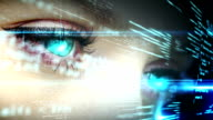 Eyes looking at holographic interface with text video