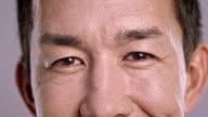 Eyes of a flirty Asian man video