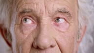 Eyes of a senior Caucasian man looking around video