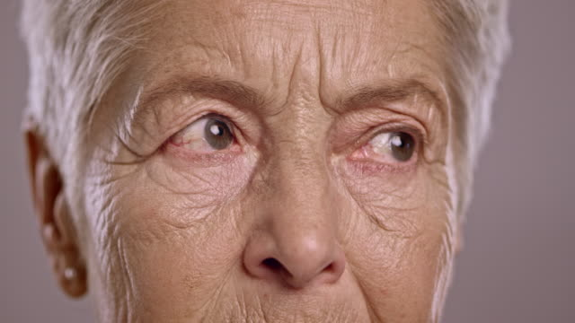 Eyes of a senior Caucasian woman looking around video