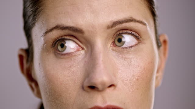 Eyes of a young Caucasian woman looking around video