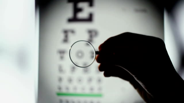 Eyesight examination, optometrist choosing lenses for glasses video