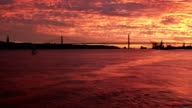 fabulous bloody sunset over Tagus river fron a boat Lisbon video