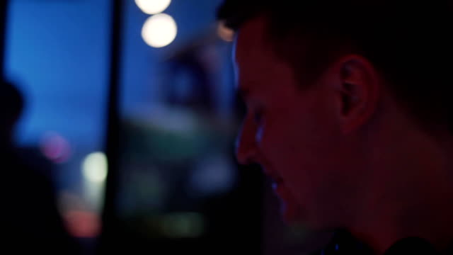 Face of Dj speak with man at turntable on party in nightclub. Mixing. Equipment video