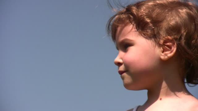 Face of little girl on sky video