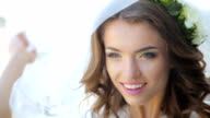 Face of the young beautiful bride lifting the white wedding veil video