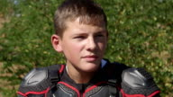 Face of young racer in motorcycle protective gear closeup video