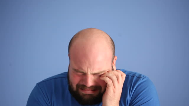 Facial Expression Of Crying Adult Man On Blue Background video