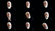 Facial expressions montage of senior man with beard, black background video