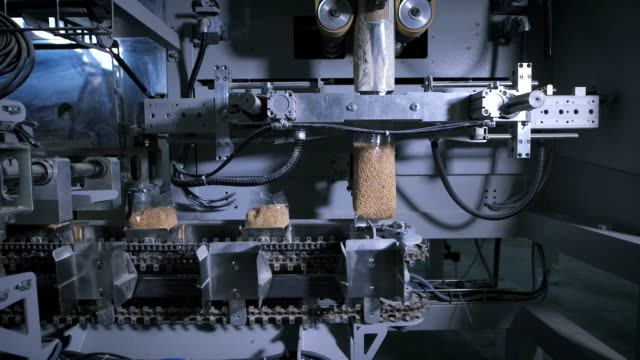 Factory for packing of cereals and other food products. There packing rice video