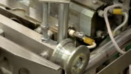 Factory packing machine with pipes and rolls video