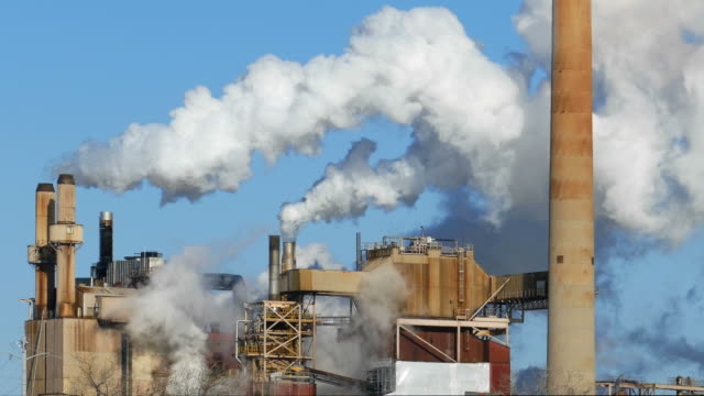 Factory Smoke Stacks Belch Thick Smoke into the Sky video