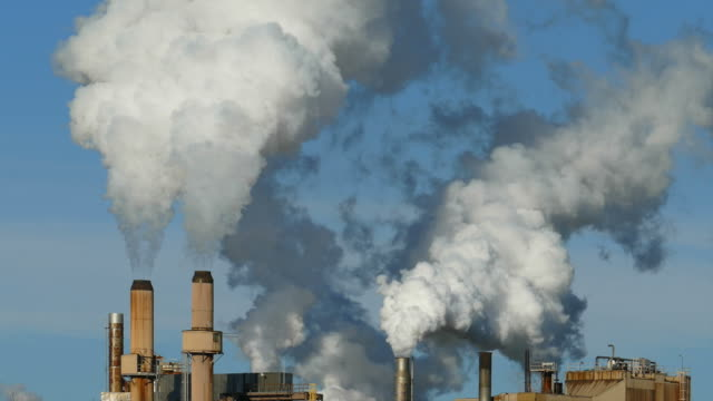 Factory Smoke Stacks Launch Thick Smoke/Steam Emissions Into Sky video