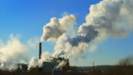 Factory smokestacks belting out smoke and steam, time lapse video