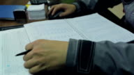 Factory Worker Making Notes At The Desk video