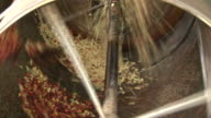 Fairtrade coffee beans peeled at coffeefactory video
