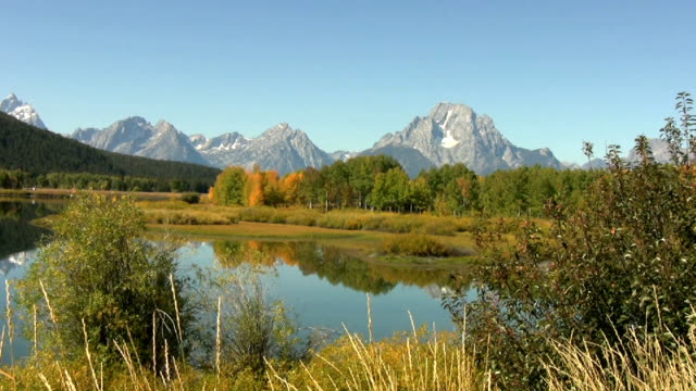 Fall Colors begin to show below the mountains video