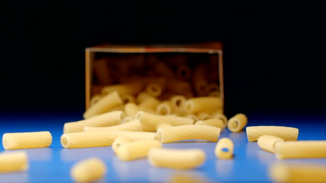 SLOW MOTION: Falling a box with a big macaroni (tortiglioni) video