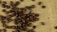 Falling coffee beans on a rotating cloth burlap video