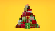 Falling down shape of christmas tree and gifts video