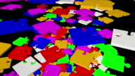 Falling, rotating abstract puzzle pieces in multicolor video