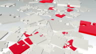 Falling, rotating abstract puzzle pieces in white and red video