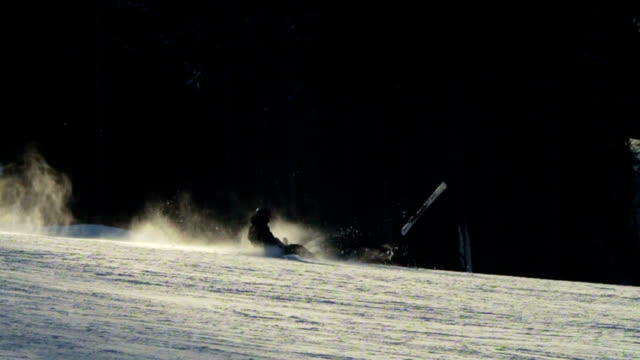 Falling skier who goes on ski track. Slow motion video