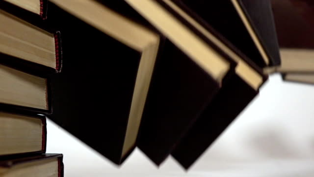 Falling stack of books super slow motion shot. Falling popularity or censorship concepts video