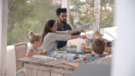 Families Enjoying Outdoor Meal On Terrace Together video