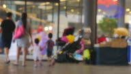 UHD/4k Apple ProRes (HQ) : Family and couple walking and shopping. video