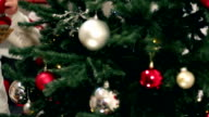 family around christmas tree video
