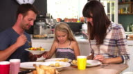 Family At Home Eating Lunch Together video