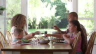 Family At Home Eating Meal In Dining Room Together video